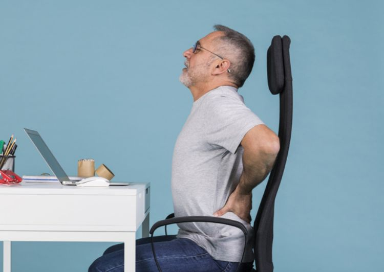 man facing lower back pain